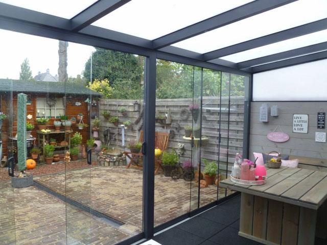 Met een afgesloten veranda kan je ook in de winter van je tuin