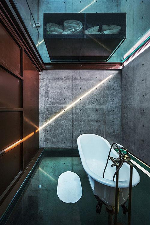 badkamers voorbeelden industrieel betonnen muren