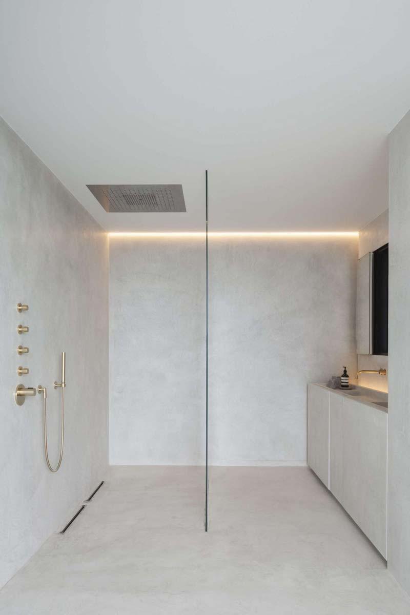 betonlook muur betonstuc badkamer