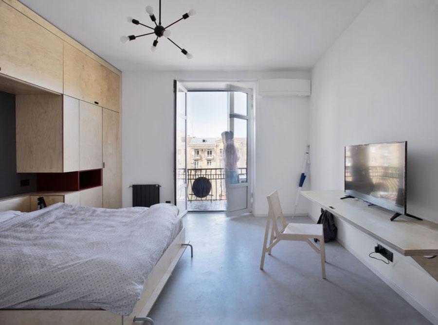 Deze mooie slaapkamer is ingericht met een inbouwkast met inklapbaar bed!