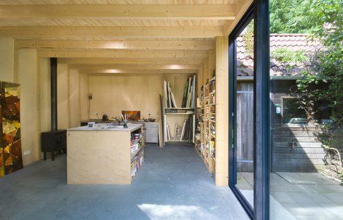 Glazen schuifpui atelier