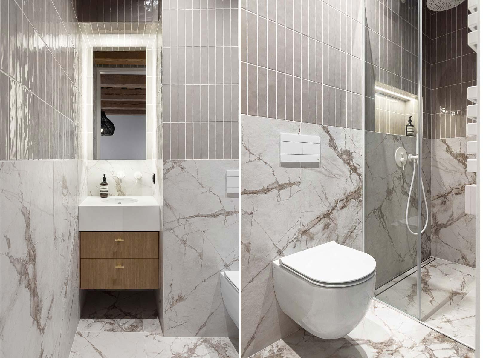 Super mooie badkamer met een bijpassend modern hangtoilet, gecombineerd met marmeren tegels. Klik hier voor de hele binnenkijker.