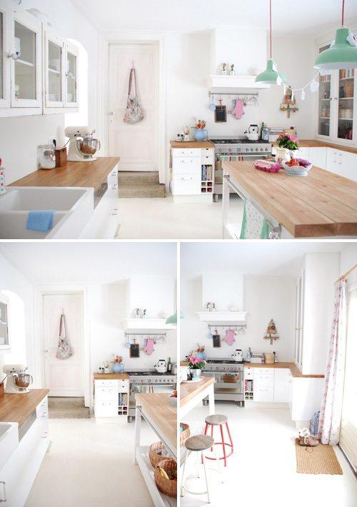 Houten keukenblad op witte kasten