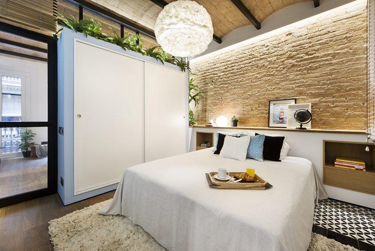 Industrieel interieur bakstenen muur slaapkamer