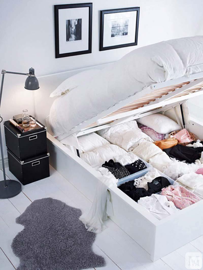 kleine slaapkamer inrichten bed met opbergruimte