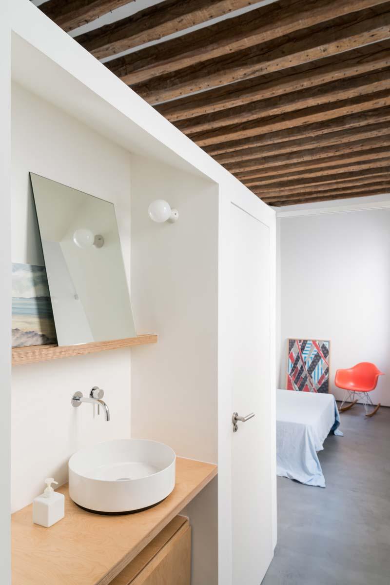 open badkamer slaapkamer betonvloer