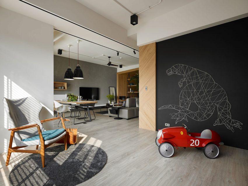 open-bibliotheek-woonkamer-krijtbord-muur
