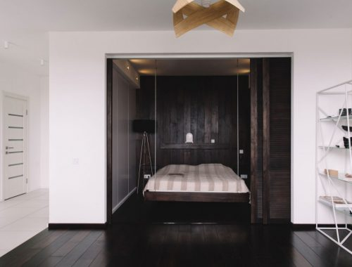 De slaapkamer van dit kleine appartement van 50m2 is super stoer ingericht!