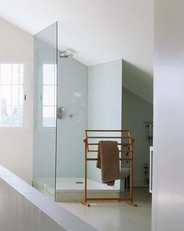 Van donkere zolder naar lichte luxe slaapkamer suite