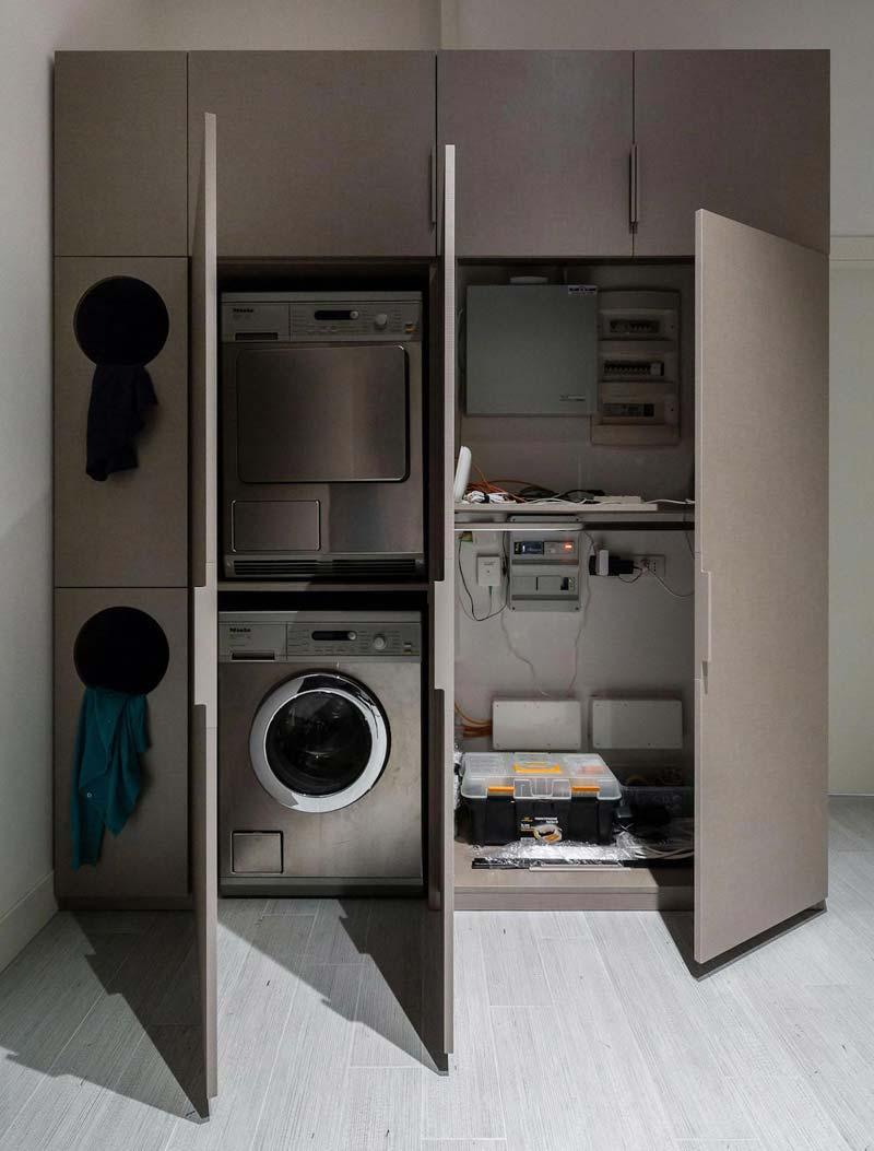 Op maat gemaakte wasmachine kast in de hal