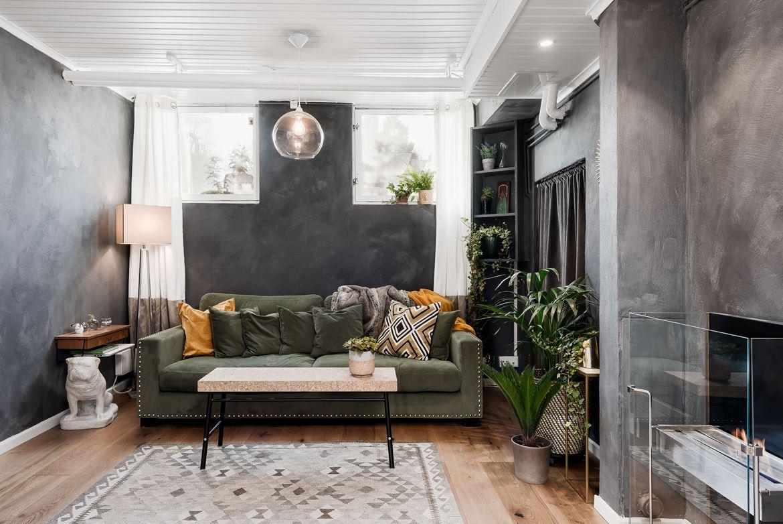 woonkamer ideeën betonstuc muren - groene bank